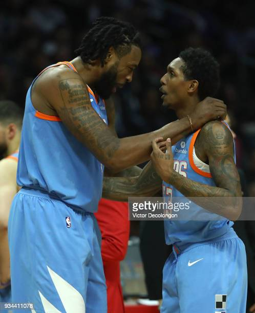 DeAndre Jordan and Lou Williams of the Los Angeles Clippers react after a play during the NBA game between the Orlando Magic and the Los Angeles...