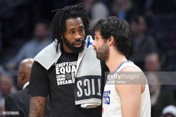 DeAndre Jordan and Milos Teodosic of the LA Clippers talk during a timeout during the game against the Denver Nuggets at Pepsi Center on February 27...