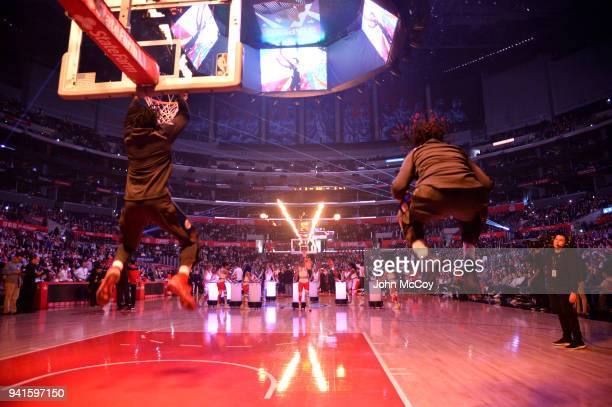 DeAndre Jordan and Montrezl Harrell of the Los Angeles Clippers warm up during pregame activities at Staples Center on April 1 2018 in Los Angeles...