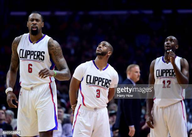 DeAndre Jordan Chris Paul and Luc Mbah a Moute of the LA Clippers wait for video review of a play during a 122103 Houston Rocket win at Staples...