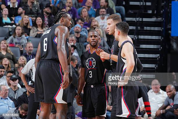 DeAndre Jordan Chris Paul Blake Griffin and JJ Redick of the Los Angeles Clippers huddle during the game against the Sacramento Kings on November 18...