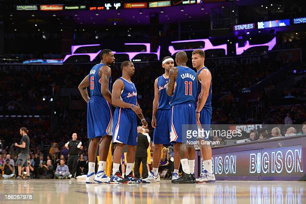 DeAndre Jordan Chris Paul Jared Dudley Jamal Crawford and Blake Griffin of the Los Angeles Clippers huddle together during their game against the Los...