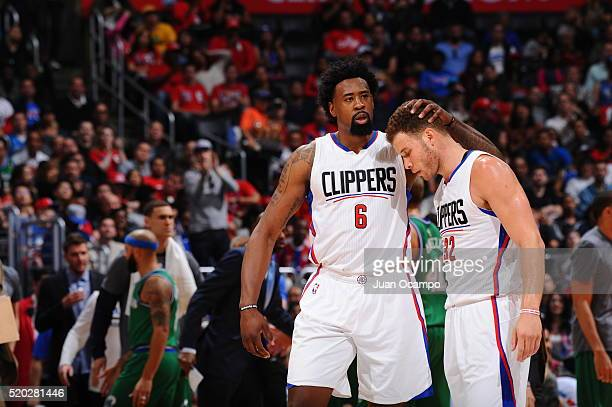 DeAndre Jordan hugs Blake Griffin of the Los Angeles Clippers during the game against the Dallas Mavericks on April 10 2016 at STAPLES Center in Los...