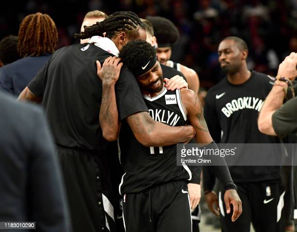 DeAndre Jordan hugs Kyrie Irving of the Brooklyn Nets after their 127-126 loss to the Minnesota Timberwolves at Barclays Center on October 23, 2019...