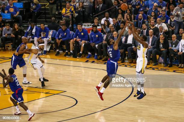 DeAndre Jordan of LA Clippers in action against Kevin Durant of Golden State Warriors during the NBA basketball game between LA Clippers and Golden...