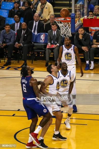 DeAndre Jordan of LA Clippers in action against Zaza Pachulia Draymond Green and Kevin Durant of Golden State Warriors during the NBA basketball game...