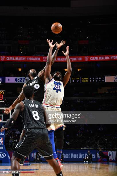 DeAndre Jordan of the Brooklyn Nets and Joel Embiid of the Philadelphia 76ers fight for the rebound on April 14, 2021 at Wells Fargo Center in...