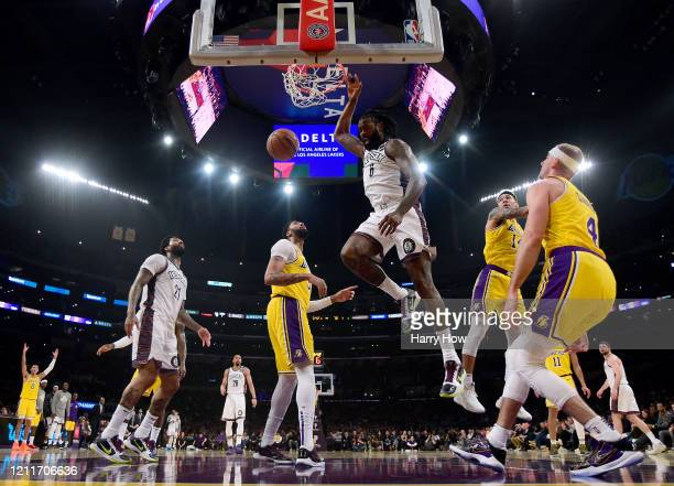 DeAndre Jordan of the Brooklyn Nets dunks in front of Anthony Davis Danny Green and Alex Caruso of the Los Angeles Lakers during a 104102 Nets win at...