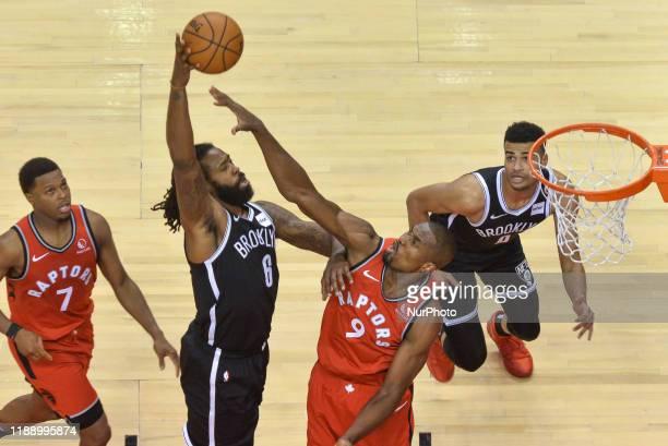 DeAndre Jordan of the Brooklyn Nets dunks over during the Toronto Raptors vs Brooklyn Nets NBA regular season game at Scotiabank Arena on December 14...