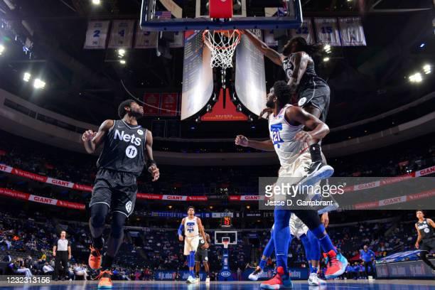 DeAndre Jordan of the Brooklyn Nets dunks the ball against Joel Embiid of the Philadelphia 76ers on April 14, 2021 at Wells Fargo Center in...