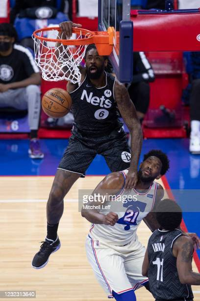 DeAndre Jordan of the Brooklyn Nets dunks the ball over Joel Embiid of the Philadelphia 76ers in the first quarter at the Wells Fargo Center on April...