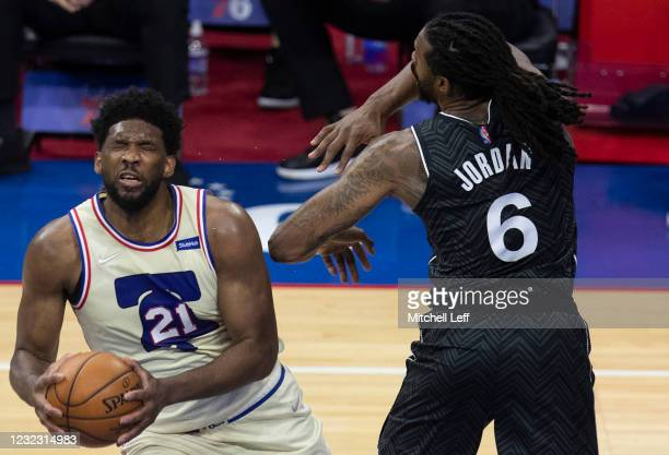DeAndre Jordan of the Brooklyn Nets fouls Joel Embiid of the Philadelphia 76ers in the third quarter at the Wells Fargo Center on April 14, 2021 in...