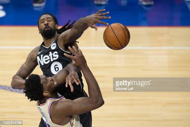 DeAndre Jordan of the Brooklyn Nets guards Joel Embiid of the Philadelphia 76ers in the third quarter at the Wells Fargo Center on April 14, 2021 in...