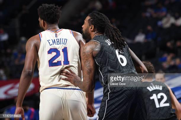 DeAndre Jordan of the Brooklyn Nets plays defense against Joel Embiid of the Philadelphia 76ers on April 14, 2021 at Wells Fargo Center in...