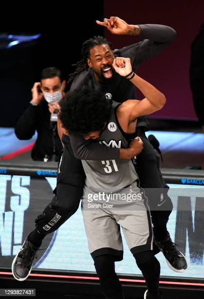 DeAndre Jordan of the Brooklyn Nets reacts with Jarrett Allen after the second half against the Atlanta Hawks at Barclays Center on December 30, 2020...
