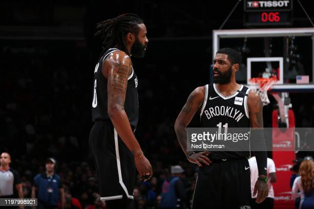 DeAndre Jordan of the Brooklyn Nets shares a conversation with teammate Kyrie Irving during the game against the Washington Wizards on February 1...