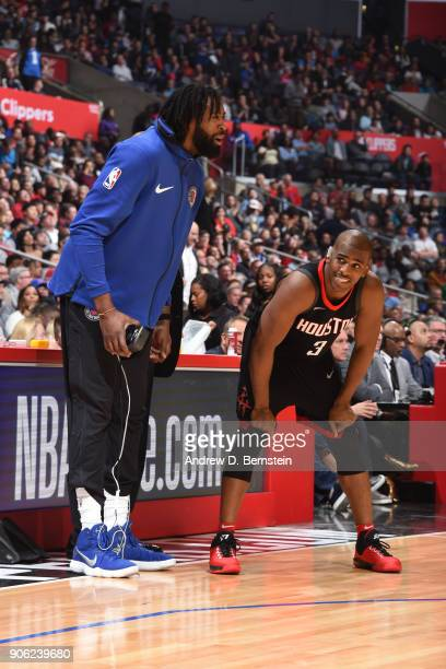 DeAndre Jordan of the LA Clippers and Chris Paul of the Houston Rockets look on during the game between the two teams on January 15 2018 at STAPLES...