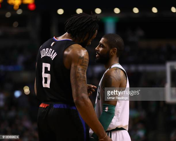 DeAndre Jordan of the LA Clippers and Kyrie Irving of the Boston Celtics talk during the first quarter of the game at TD Garden on February 14 2018...