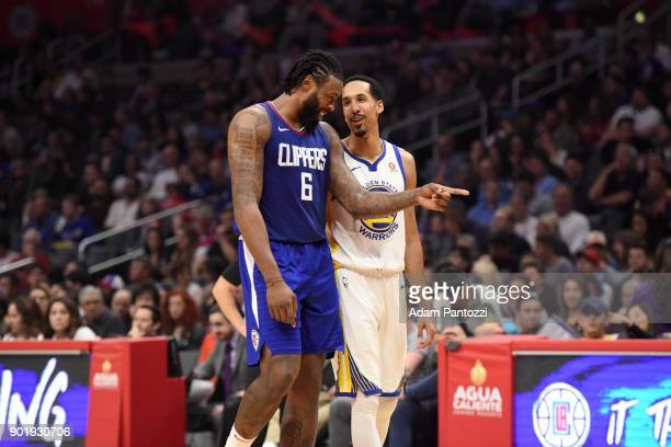 DeAndre Jordan of the LA Clippers and Shaun Livingston of the Golden State Warriors during the game on January 6 2018 at STAPLES Center in Los...