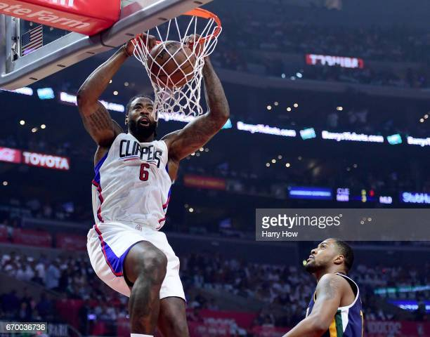 DeAndre Jordan of the LA Clippers dunks in front of Derrick Favors of the Utah Jazz during the first half in Game Two of the Western Conference...