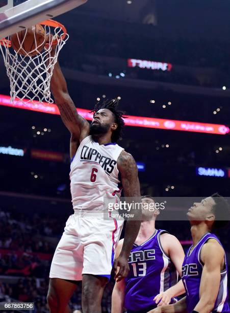 DeAndre Jordan of the LA Clippers dunks in front of Georgios Papagiannis and Skal Labissiere of the Sacramento Kings during the first half at Staples...