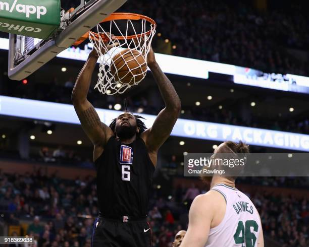 DeAndre Jordan of the LA Clippers dunks over Aron Baynes of the Boston Celtics during the first quarter of the game at TD Garden on February 14 2018...