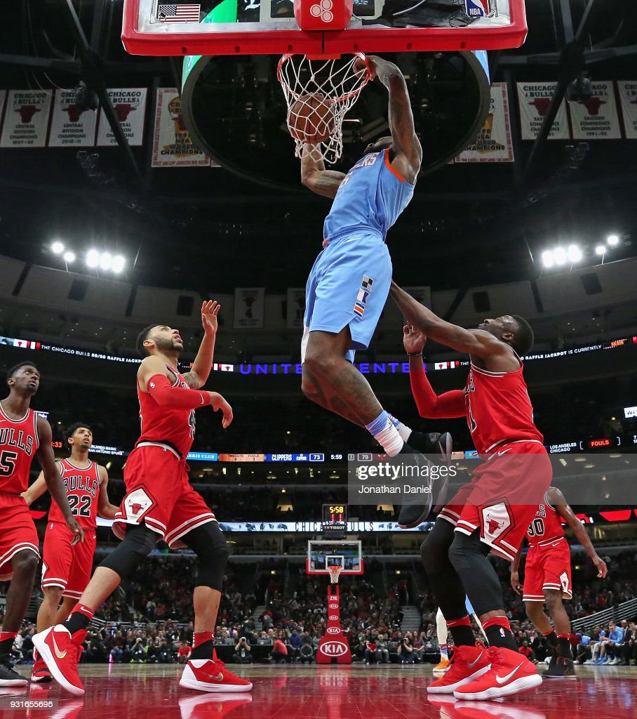 DeAndre Jordan #6 of the LA Clippers dunks over Denzel Valentine #45 (L) and David Nwaba #11 of the Chicago Bulls at the United Center on March 13, 2018 in Chicago, Illinois. The Clippers defeated the Bulls 112-106.
