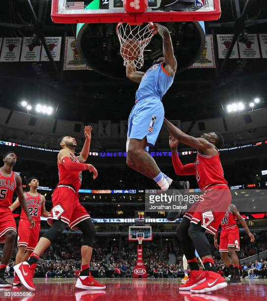 DeAndre Jordan of the LA Clippers dunks over Denzel Valentine and David Nwaba of the Chicago Bulls at the United Center on March 13 2018 in Chicago...