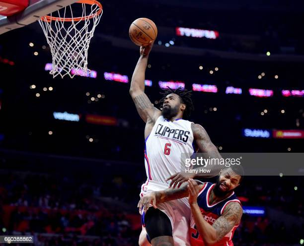 DeAndre Jordan of the LA Clippers dunks over Markieff Morris of the Washington Wizards during a 133124 Clipper win at Staples Center on March 29 2017...