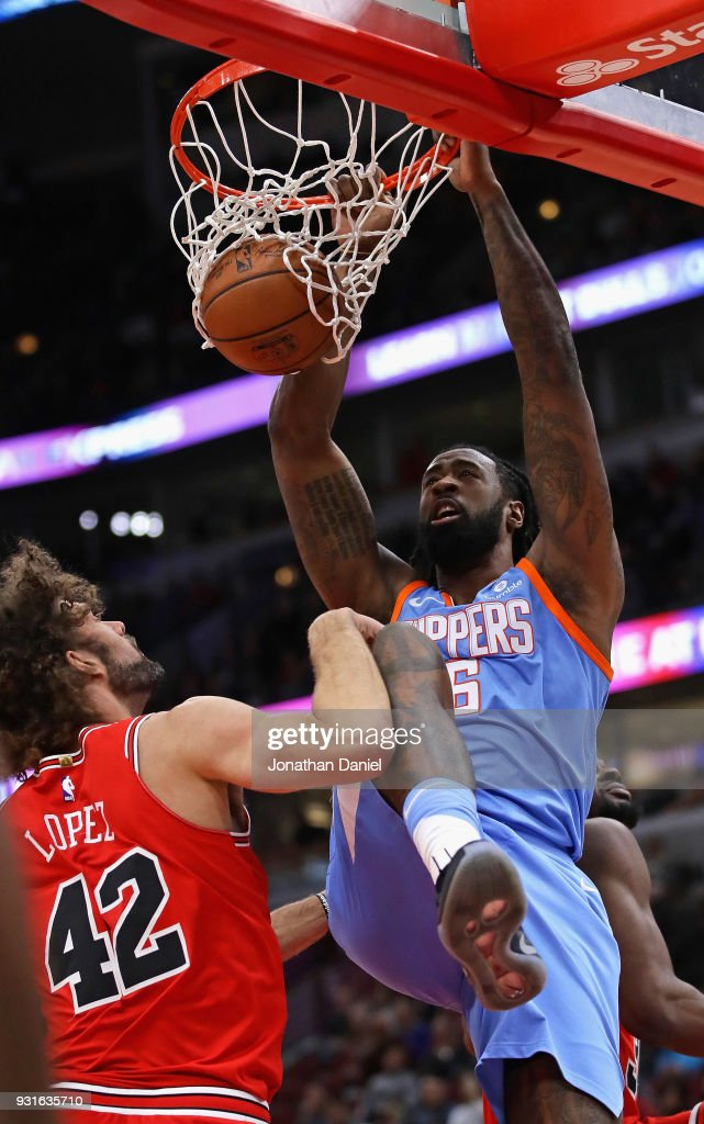 DeAndre Jordan #6 of the LA Clippers dunks over Robin Lopez #42 of the Chicago Bulls at the United Center on March 13, 2018 in Chicago, Illinois.