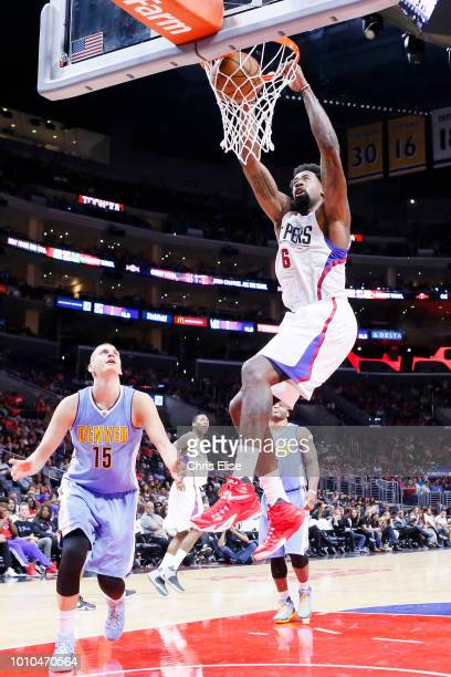 DeAndre Jordan of the LA Clippers dunks the ball against the Denver Nuggets on October 2 2015 at the Staples Center in Los Angeles California USA...
