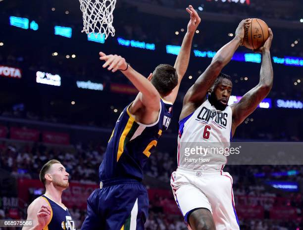 DeAndre Jordan of the LA Clippers grabs a rebound from Jeff Withey and Gordon Hayward of the Utah Jazz during the first half at Staples Center on...