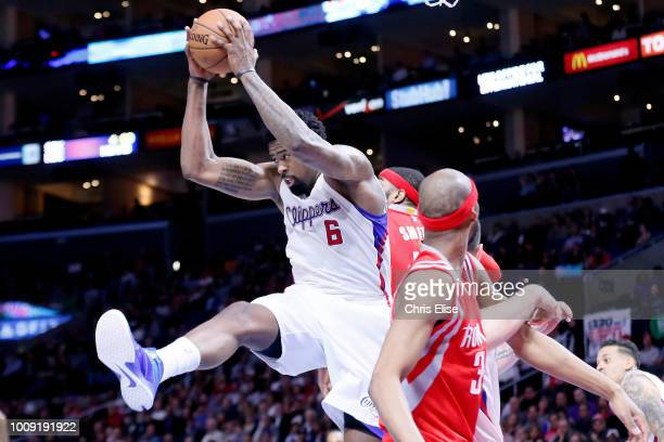 DeAndre Jordan of the LA Clippers grabs the rebound against the Houston Rockets on February 11 2015 at the STAPLES Center in Los Angeles California...