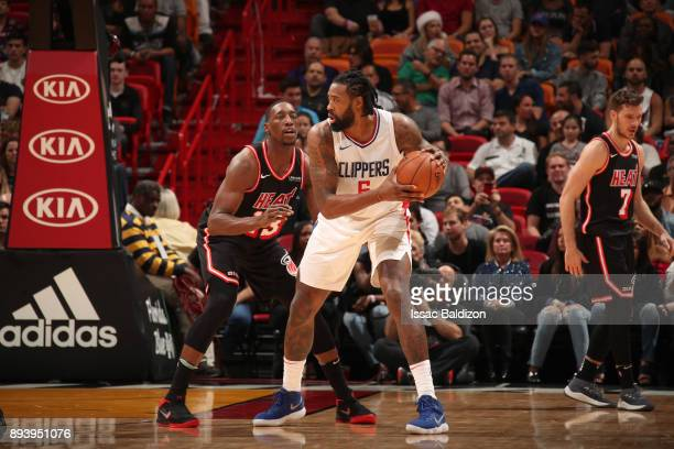 DeAndre Jordan of the LA Clippers handles the ball against the Miami Heat on December 16 2017 at American Airlines Arena in Miami Florida NOTE TO...