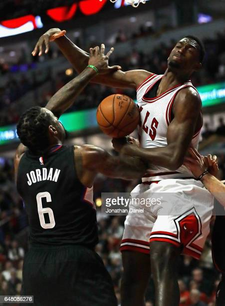 DeAndre Jordan of the LA Clippers knocks the ball away from Bobby Portis of the Chicago Bulls at the United Center on March 4 2017 in Chicago...