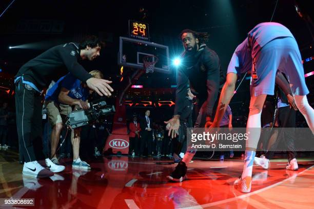 DeAndre Jordan of the LA Clippers makes his entrance before the game against the Portland Trail Blazers on March 18 2018 at STAPLES Center in Los...