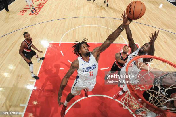 DeAndre Jordan of the LA Clippers reaches for the ball during the 2017 NBA PreSeason game against the Portland Trail Blazers on October 8 2017 at...