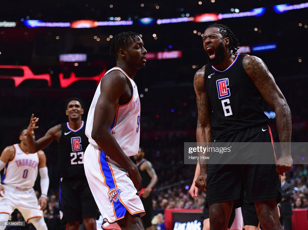 DeAndre Jordan #6 of the LA Clippers reacts after his dunk in front of Jerami Grant #9 of the Oklahoma City Thunder during a 127-117 Thunder win at Staples Center on January 4, 2018 in Los Angeles, California.