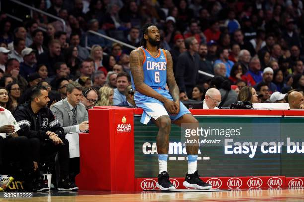 DeAndre Jordan of the LA Clippers sits on the sidelines before entering the game during the second half against the Portland Trail Blazers at the...