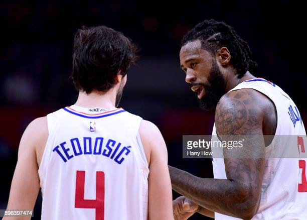 DeAndre Jordan of the LA Clippers speaks with Milos Teodosic during a 108-95 win over the Phoenix Suns at Staples Center on December 20, 2017 in Los...