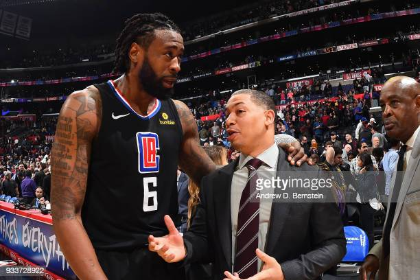 DeAndre Jordan of the LA Clippers talks with Head Coach Tyronn Lue of the Cleveland Cavaliers after the game between the two teams on March 9 2018 at...