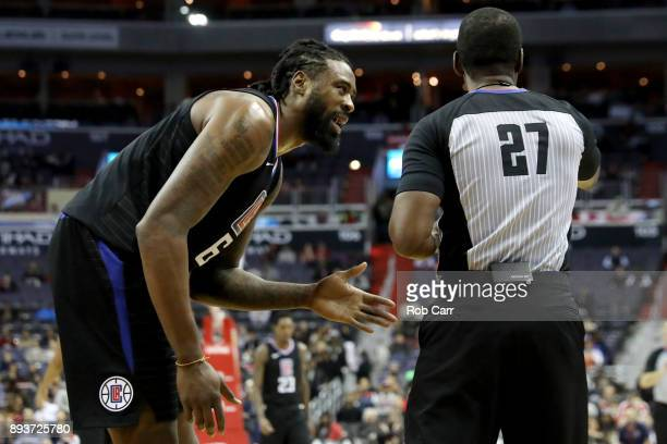 DeAndre Jordan of the LA Clippers talks with referee Mitchell Ervin after being called for a foul against the Washington Wizards in the first half at...