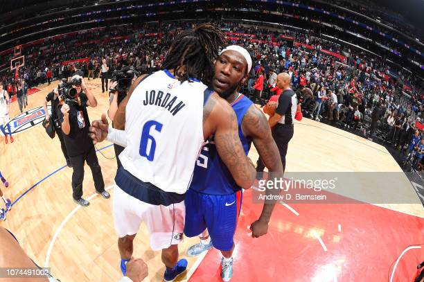 DeAndre Jordan of the Dallas Mavericks and Montrezl Harrell of the LA Clippers hug after the game on December 20 2018 at STAPLES Center in Los...