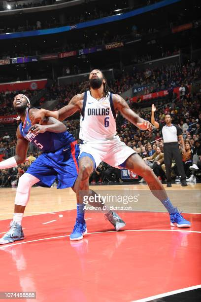 DeAndre Jordan of the Dallas Mavericks boxes out Montrezl Harrell of the LA Clippers on December 20 2018 at STAPLES Center in Los Angeles California...