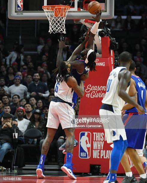 DeAndre Jordan of the Dallas Mavericks fouls Montrezl Harrell of the Los Angeles Clippers as he scores a basket during the second quarter at Staples...