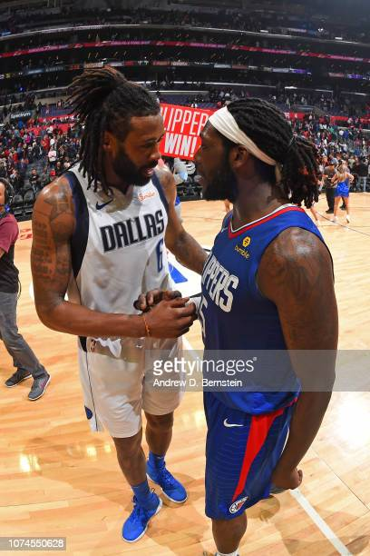 DeAndre Jordan of the Dallas Mavericks talks with Montrezl Harrell of the LA Clippers after the game on December 20 2018 at STAPLES Center in Los...