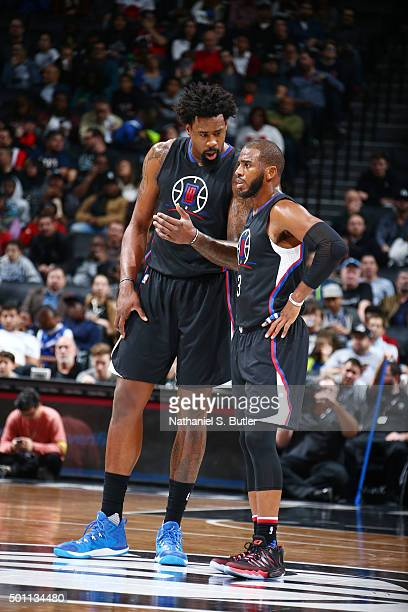 DeAndre Jordan of the Los Angeles Clippers and Chris Paul of the Los Angeles Clippers talk during the game against the Brooklyn Nets on December 12...