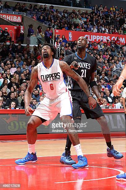 DeAndre Jordan of the Los Angeles Clippers and Kevin Garnett of the Minnesota Timberwolves fight for the position during the game on November 29 2015...