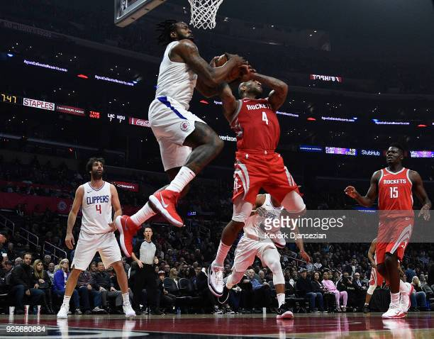 DeAndre Jordan of the Los Angeles Clippers and PJ Tucker of the Houston Rockets fight for the ball during the first half at Staples Center on...