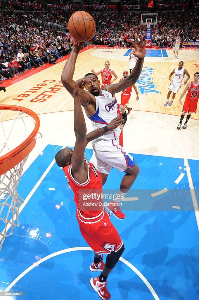 DeAndre Jordan #6 of the Los Angeles Clippers attempts a dunk over Luol Deng #9 of the Chicago Bulls at Staples Center on November 17, 2012 in Los Angeles, California.